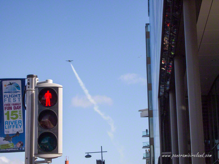 Red man traffic light and Flightfest sign with plane in sky