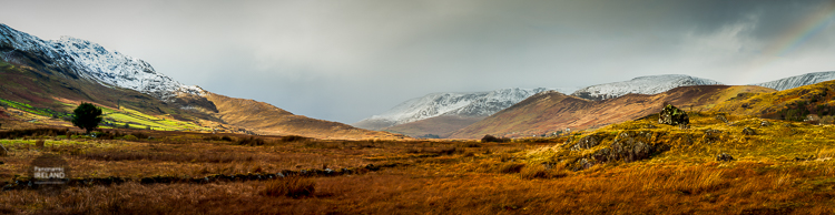 West of Ireland panorama with mountains, valley and a rainbow