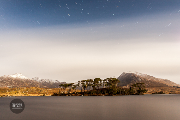 Connemara's famous Pine Island with star trails and snow