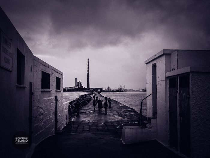 The iconic chimneys of Dublin's Poolbeg Generator provide the landmark for walkers to get their bearings.