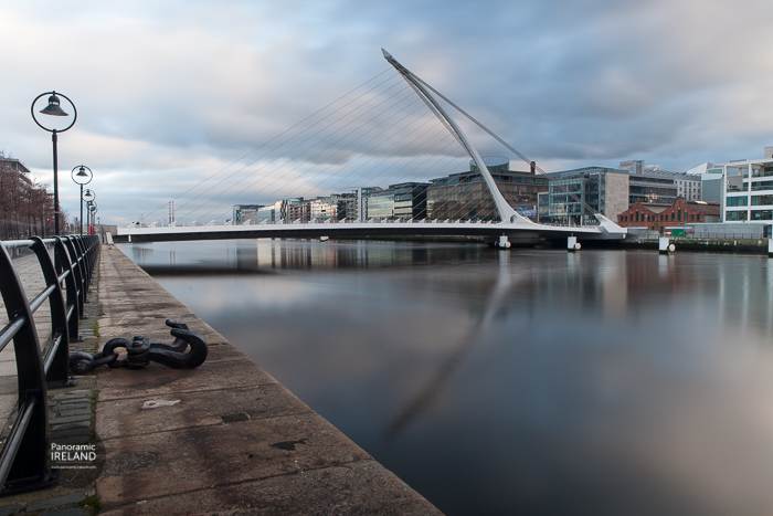 The Samuel Beckett Bridge designed by Santiago Calatrava, reflected in the River Liffey as it flows through Dublin.