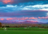 Wisping Pink Cloud over Mountains at Sunset in Ireland