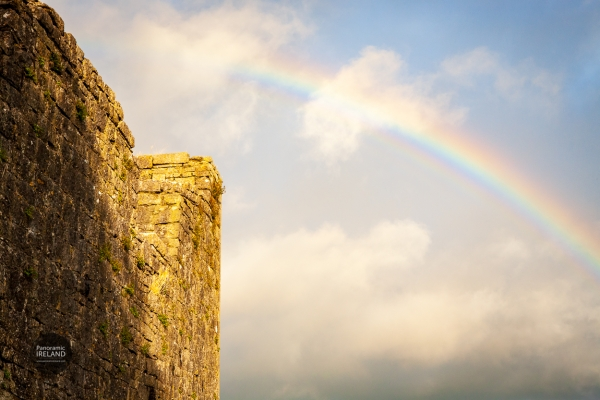 Rainbow and old stones in Ireland on a stormy day