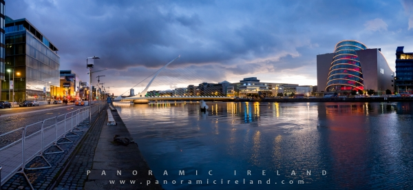 Dublin's Samuel Beckett Bridge, Convention Centre and River Liffey at night with a stormy sky