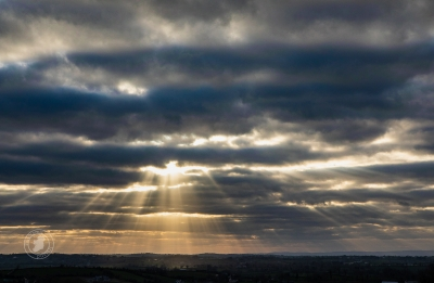 A Multitude of Sunrays from the Cloudy Western Sky