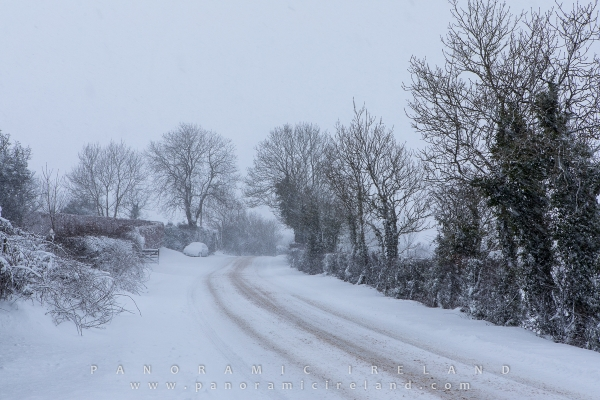 March 1st, 2018 - Irish country road white with snow, an abandoned car getting covered with heavy falling snowflakes
