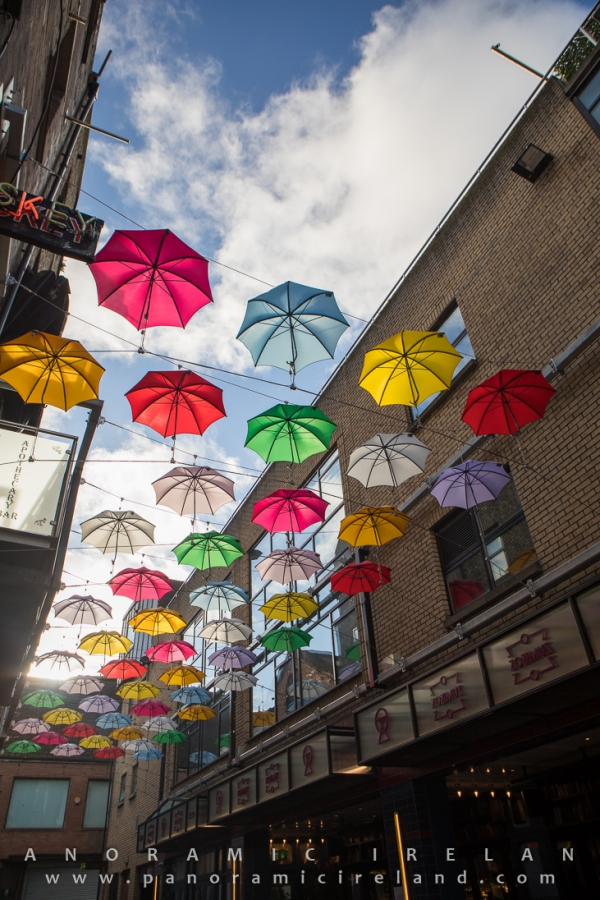 Colourful umbrellas on Dublin's Anne's Lane outside Zozimus