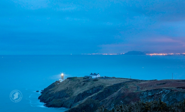 Dublin's Baily Lighthouse overlooking Dublin Bay and, beyond, the Wicklow Mountains.
