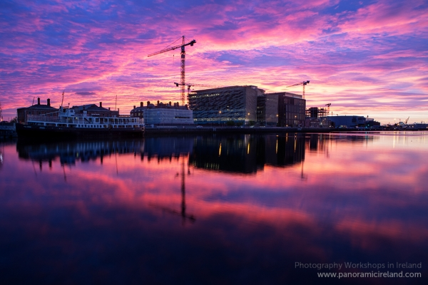 Pink, surreal morning sky above Dublin and reflected in the River Liffey
