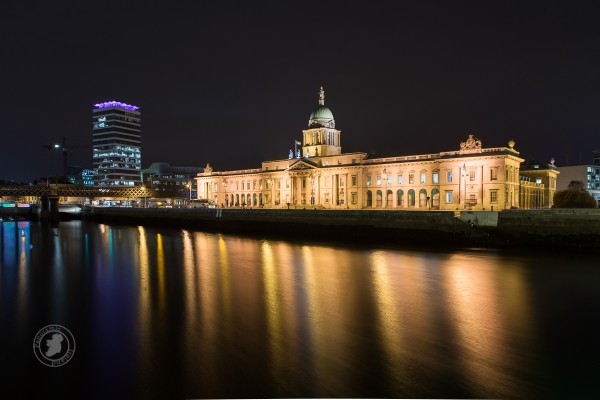 Dublin's Custom House reflected in the River Liffey at night