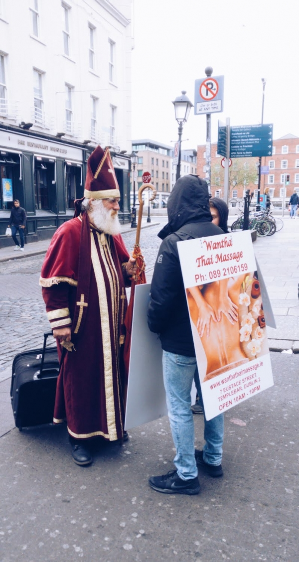 Unusual sights on the streets of Dublin, Saint with Crozier talks to street vendors